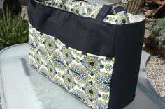 Diaper bag with a divider