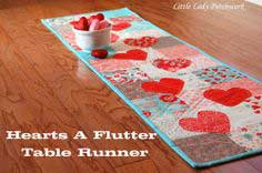 HEARTS A FLUTTER TABLE RUNNER { A CHARM PACK TUTORIAL}